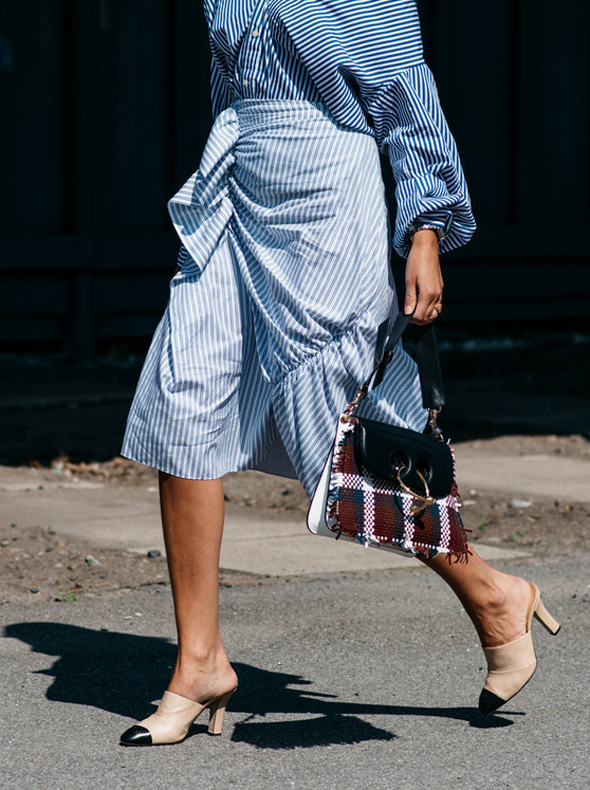 SORRY, JEANS—WE'RE MIDI SKIRT CONVERTS NOW